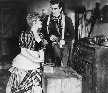 Claire Trevor and John Wayne